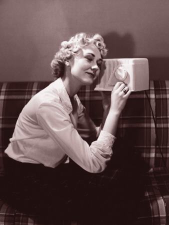 woman-sitting-listening-to-the-radio-circa-1950-s